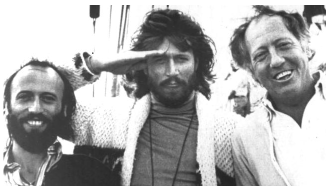 (L-R) Maurice Gibb, Barry Gibb and Robert Stigwood, in 1978