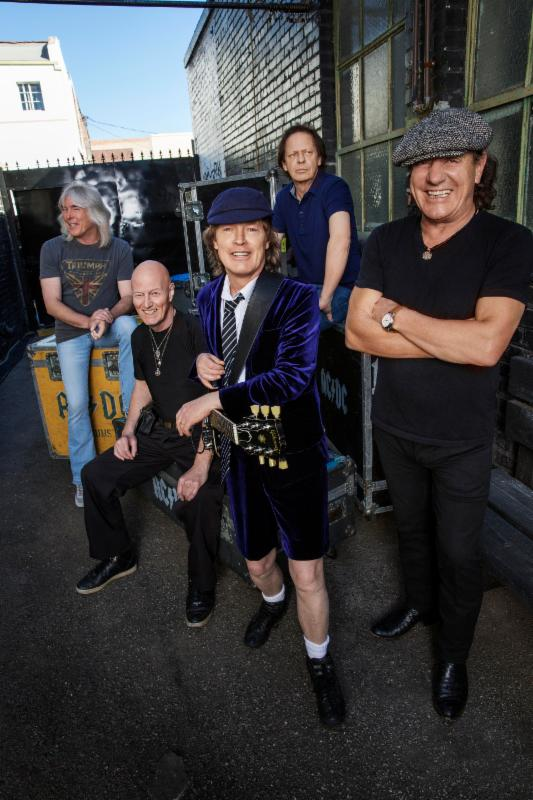 L-R: Cliff Williams, Chris Slade, Angus Young, Stevie Young and Brian Johnson. Photo By Josh Cheuse