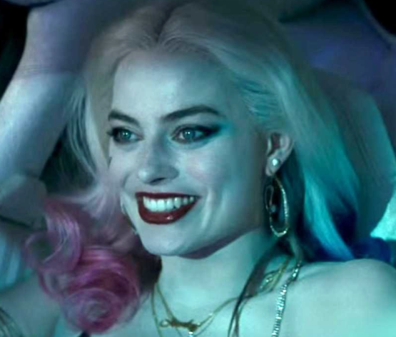Margot Robbie as Squad member Harley Quinn (screen cap from YouTube clip)