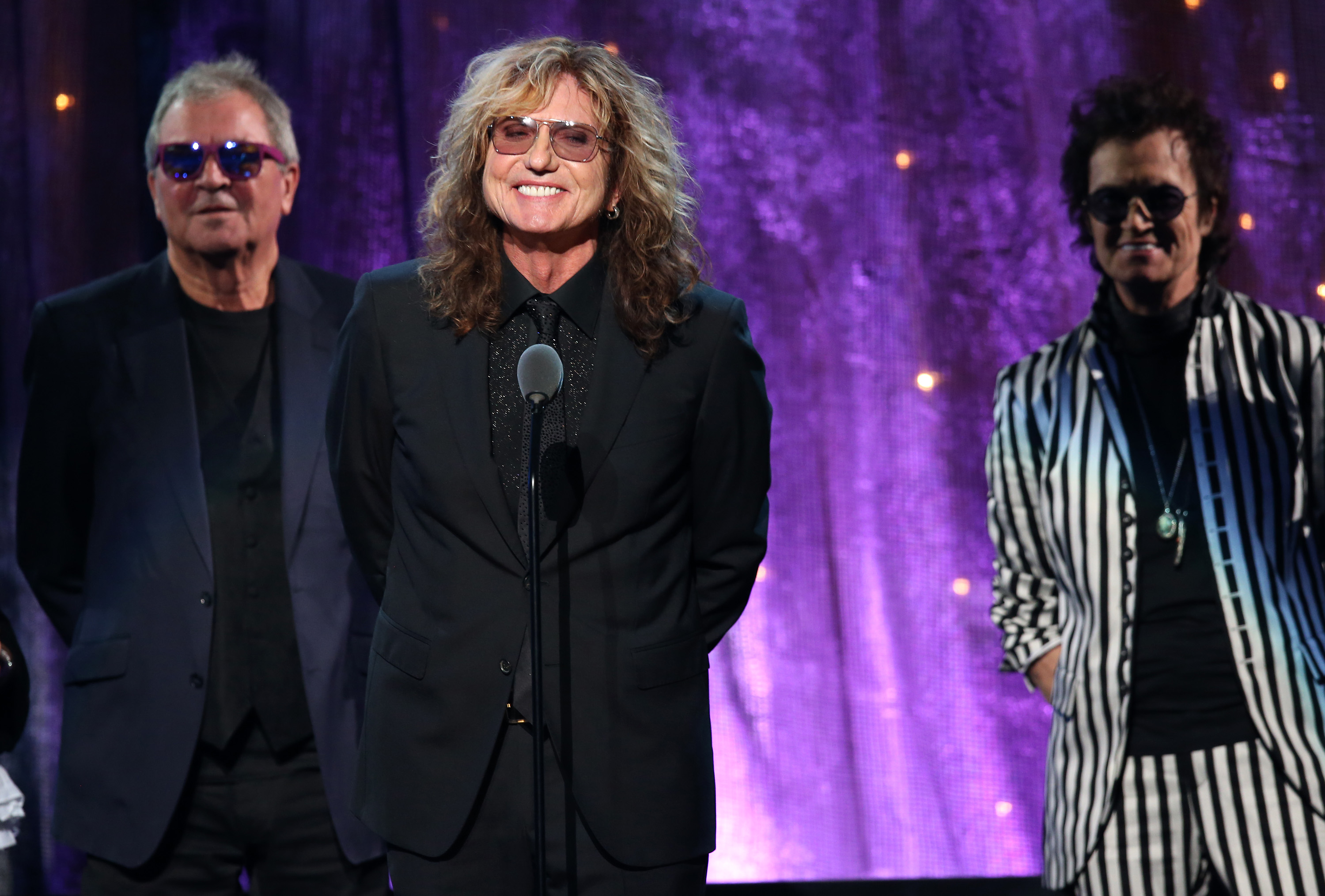"""NEW YORK, NEW YORK - APRIL 08: (L-R) Ian Gillian, David Coverdale, and Glenn Hughes of Deep Purple speak onstage at the 31st Annual Rock And Roll Hall Of Fame Induction Ceremony at Barclays Center of Brooklyn on April 8, 2016 in New York City. (Photo by Kevin Kane/WireImage for Rock and Roll Hall of Fame)"""
