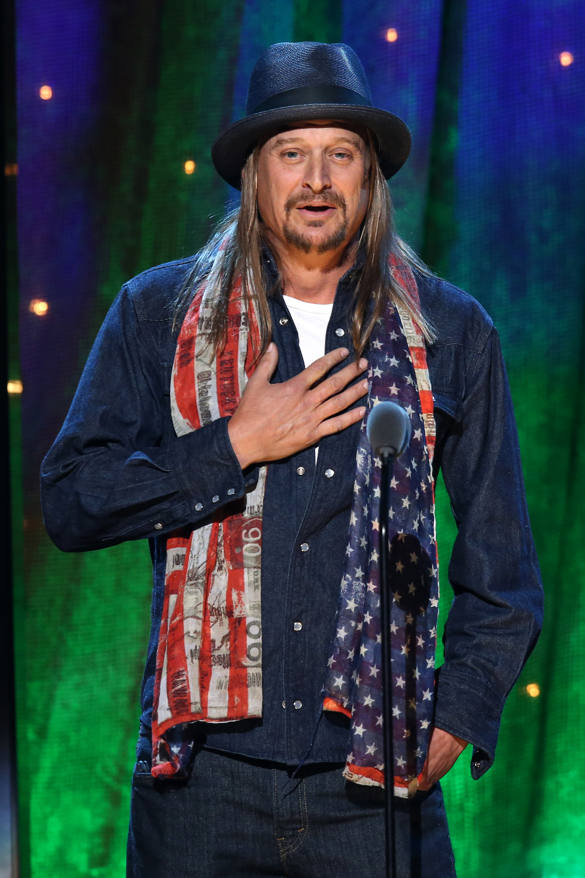"""NEW YORK, NEW YORK - APRIL 08: Kid Rock inducts Cheap Trick at the 31st Annual Rock And Roll Hall Of Fame Induction Ceremony at Barclays Center on April 8, 2016 in New York City. (Photo by Kevin Kane/WireImage for Rock and Roll Hall of Fame)"""