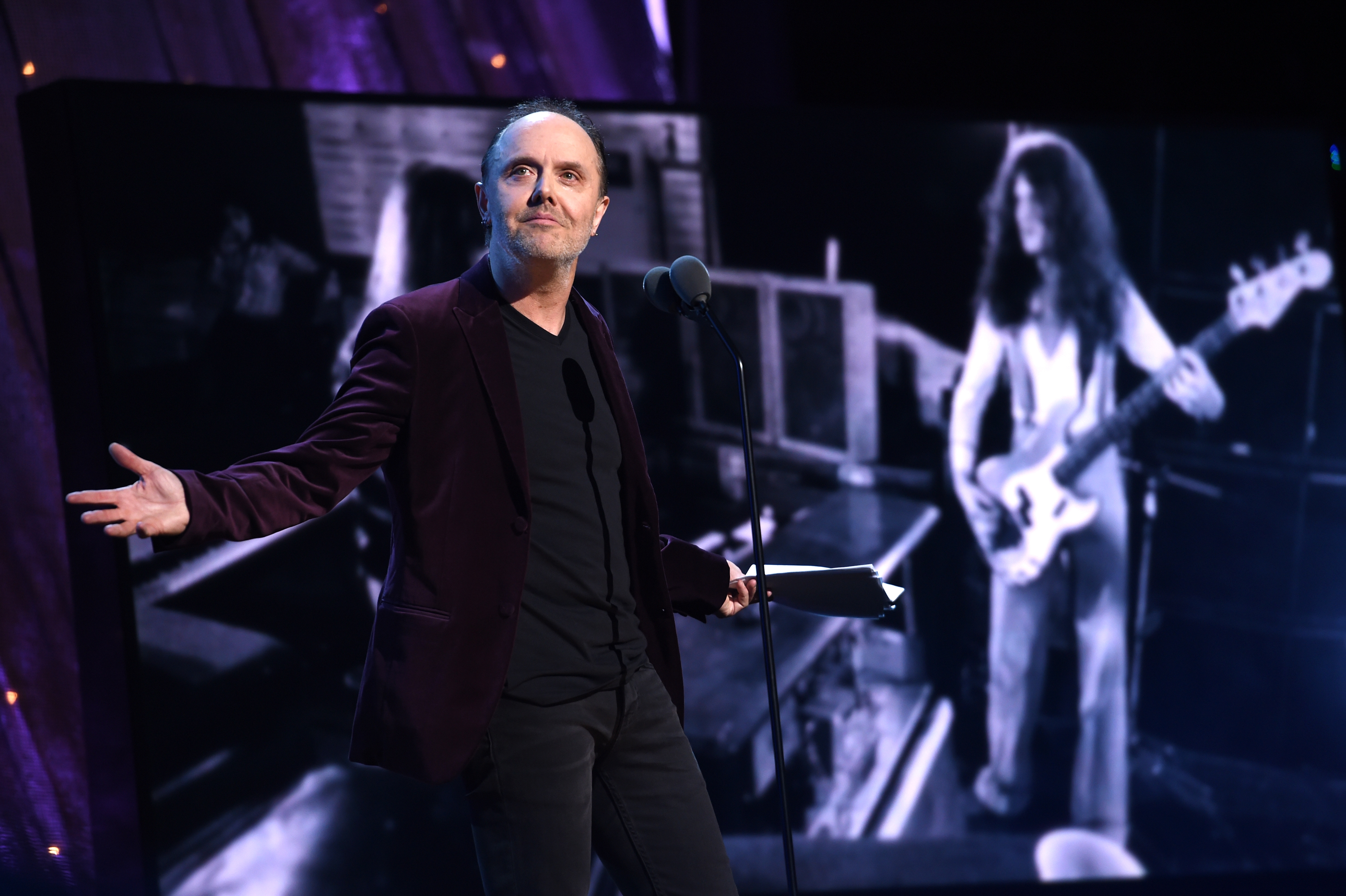 """NEW YORK, NEW YORK - APRIL 08: Lars Ulrich of Metallica inducts Deep Purple onstage at the 31st Annual Rock And Roll Hall Of Fame Induction Ceremony at Barclays Center of Brooklyn on April 8, 2016 in New York City. (Photo by Dimitrios Kambouris/WireImage for Rock and Roll Hall of Fame)"""