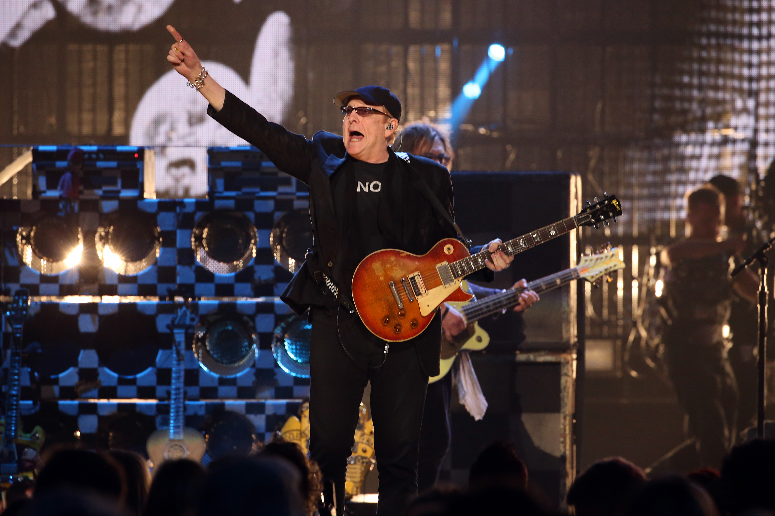 """NEW YORK, NEW YORK - APRIL 08: Rick Nielsen of Cheap Trick performs onstage at the 31st Annual Rock And Roll Hall Of Fame Induction Ceremony at Barclays Center of Brooklyn on April 8, 2016 in New York City. (Photo by Kevin Kane/WireImage for Rock and Roll Hall of Fame)"""