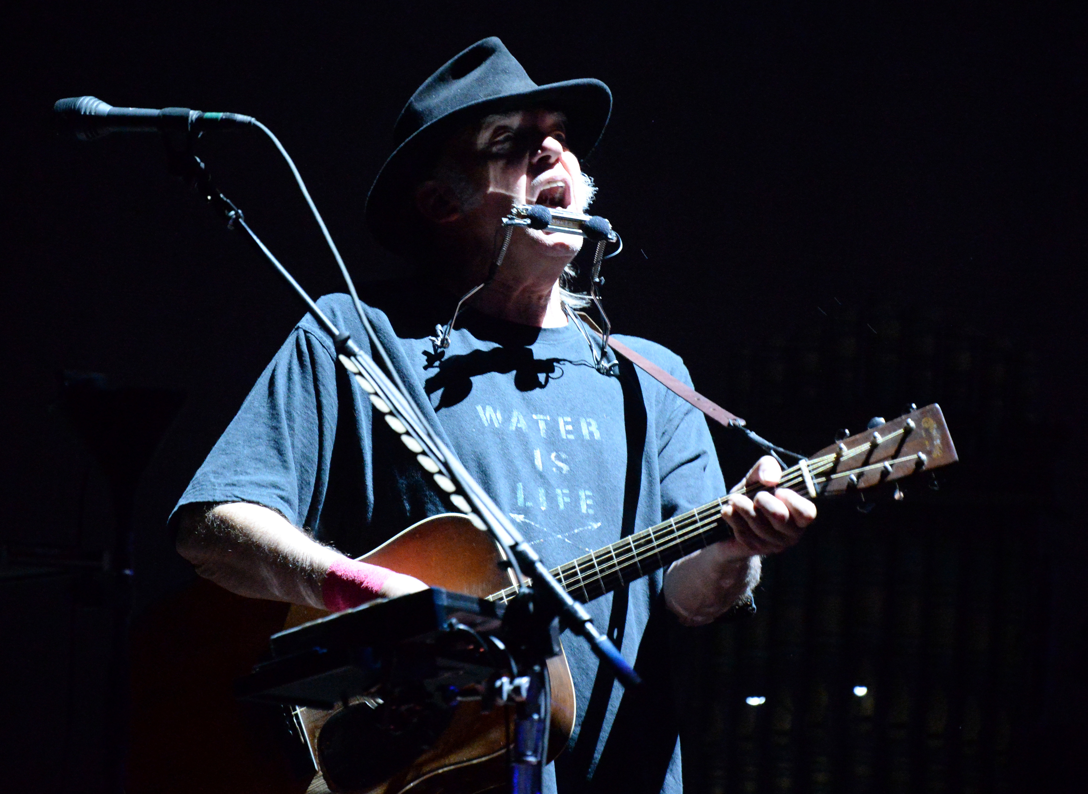 Neil Young performs onstage during Desert Trip at The Empire Polo Club on October 8, 2016 in Indio, California. (Photo by Kevin Mazur/Getty Images for Desert Trip. Used with permission)