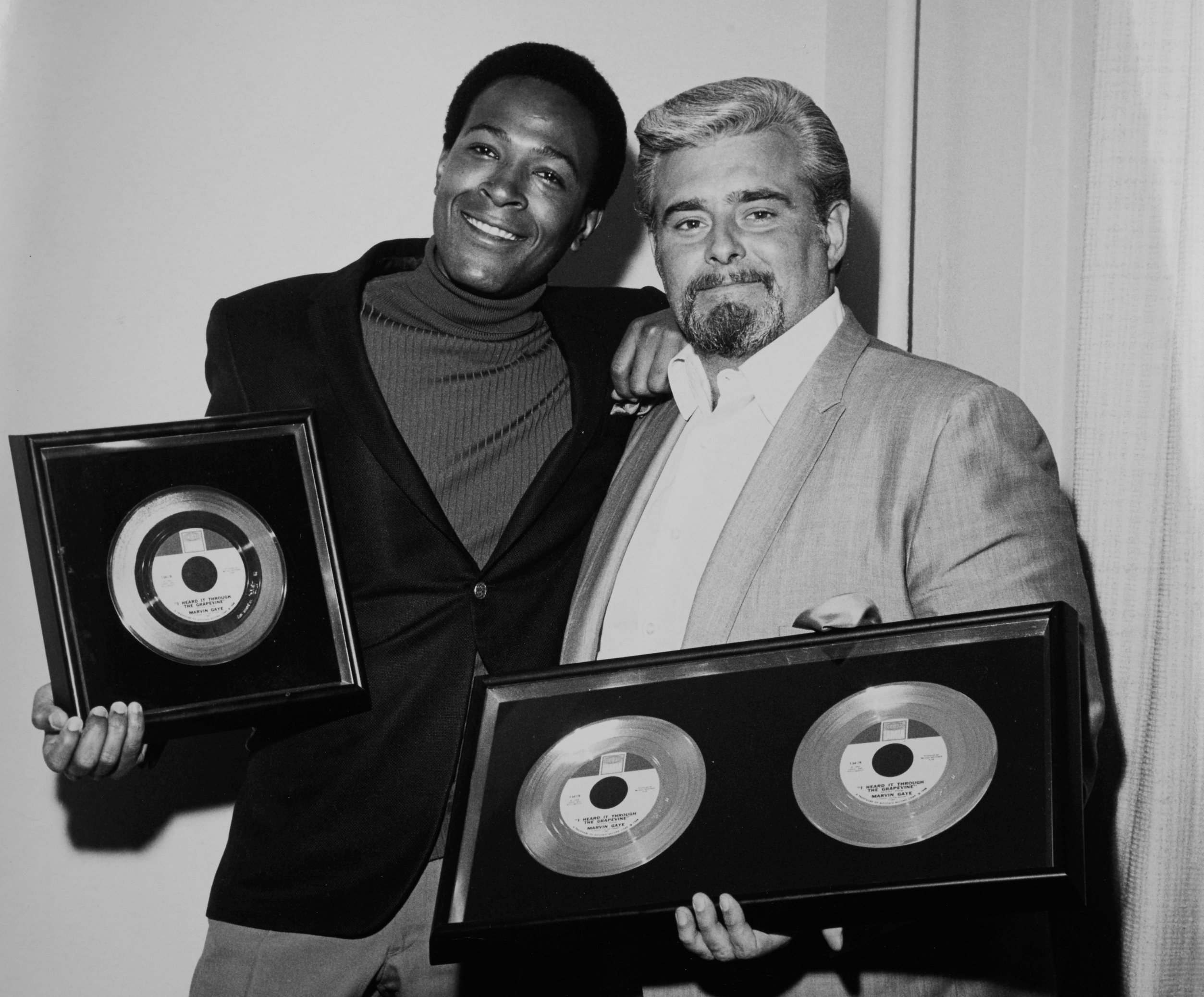 Barney Ales presents Gold Record awards to Marvin Gaye (Photo courtesy of Barney Ales. Used with permission)