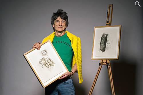 Ronnie Wood holds a drawing from his 1965 diary (Photo from the Genesis Publications website)