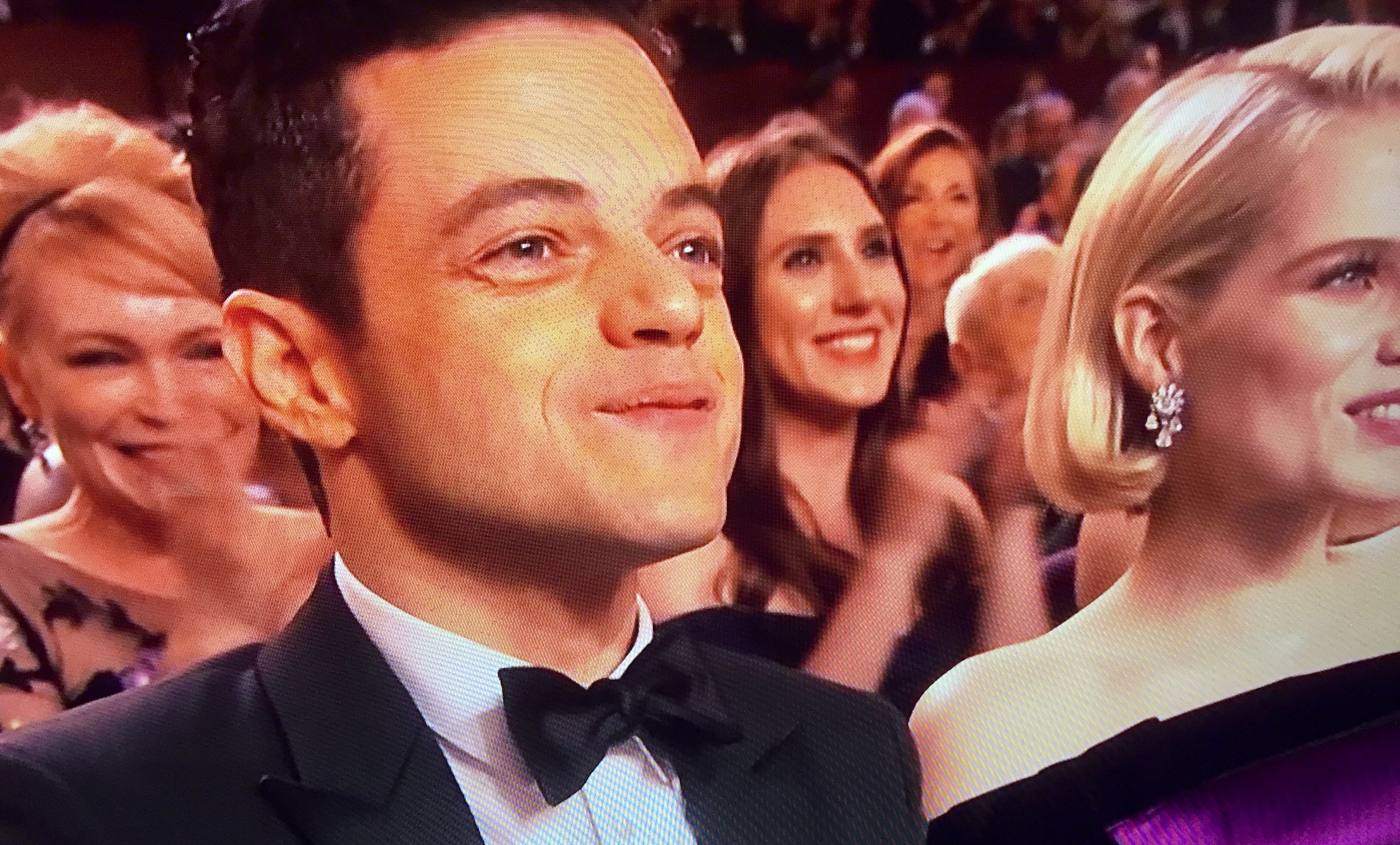 Two of Bohemian Rhapsody's stars Rami Malek and Lucy Boyton watch Queen's Oscars performance